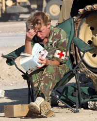 female soldier reading book