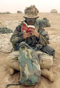 soldier reading Clive Cussler novel