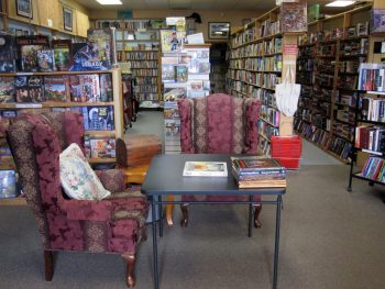 Front area of store. Relax, chat with us, read or learn to play a game.